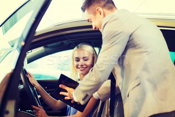 Boldog nő autókereskedő autó előadás szalon Stock fotó © dolgachov