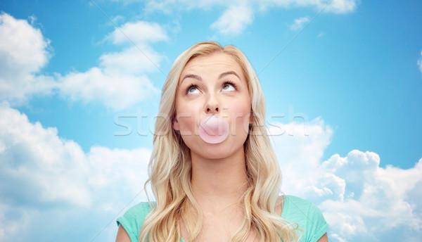 Boldog fiatal nő tinilány rág íny érzelmek Stock fotó © dolgachov