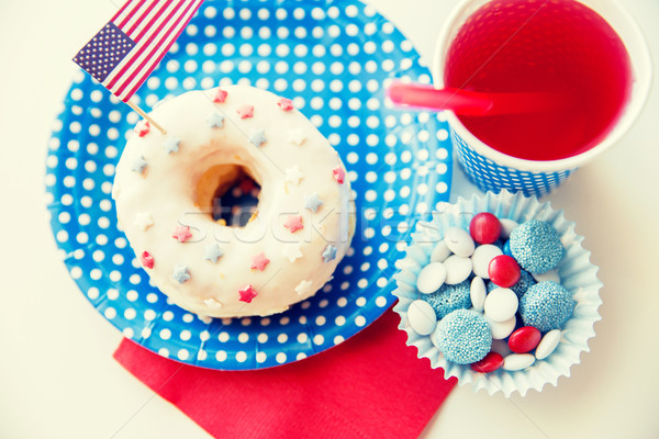 donut with juice and candies on independence day Stock photo © dolgachov