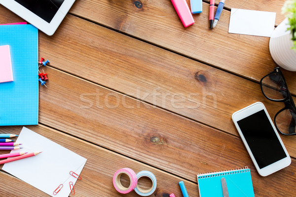 close up of stationery and smartphone on table Stock photo © dolgachov