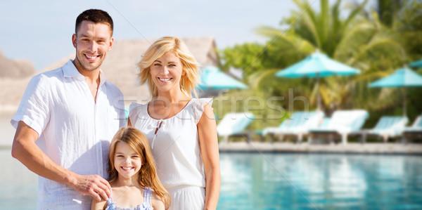 Mutlu aile otel başvurmak yüzme havuzu yaz tatil Stok fotoğraf © dolgachov