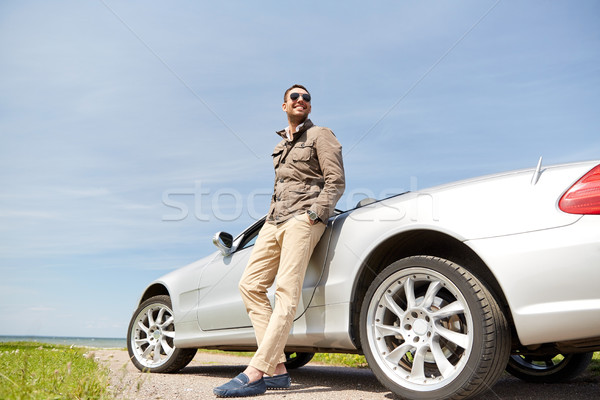 happy man near cabriolet car outdoors Stock photo © dolgachov