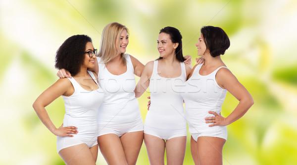 Groep gelukkig verschillend vrouwen witte ondergoed Stockfoto © dolgachov