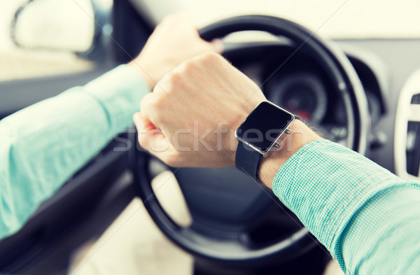 close up of man with wristwatch driving car Stock photo © dolgachov