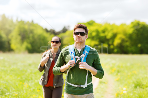 couple with backpacks hiking outdoors Stock photo © dolgachov