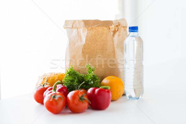 Közelkép papírzacskó zöldségek víz főzés diéta Stock fotó © dolgachov