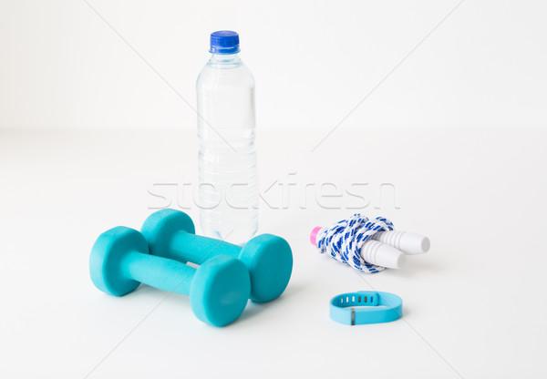 dumbbells, skipping rope, pulse tracker and bottle Stock photo © dolgachov