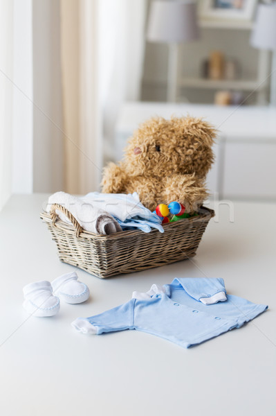 Stock photo: close up of baby clothes and toys for newborn
