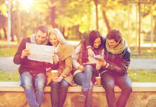 couples with tourist map in autumn park Stock photo © dolgachov