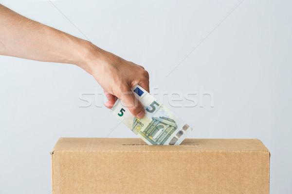 Homem euro dinheiro doação caixa caridade Foto stock © dolgachov