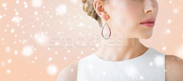 Közelkép gyönyörű nő arc fülbevaló karácsony ünnepek Stock fotó © dolgachov