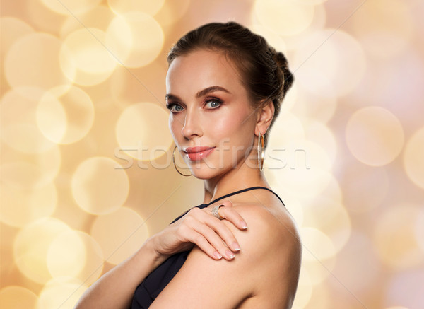 beautiful woman in black wearing diamond jewelry Stock photo © dolgachov