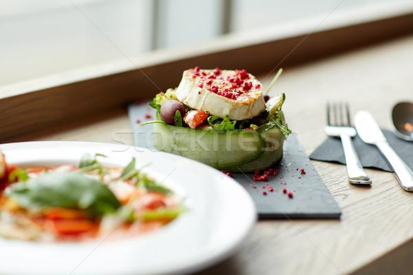 goat cheese salad and gazpacho soup at restaurant Stock photo © dolgachov