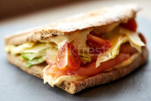 Stock photo: salmon panini sandwich on stone plate