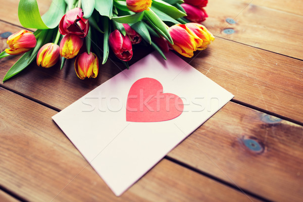 close up of flowers and greeting card with heart Stock photo © dolgachov
