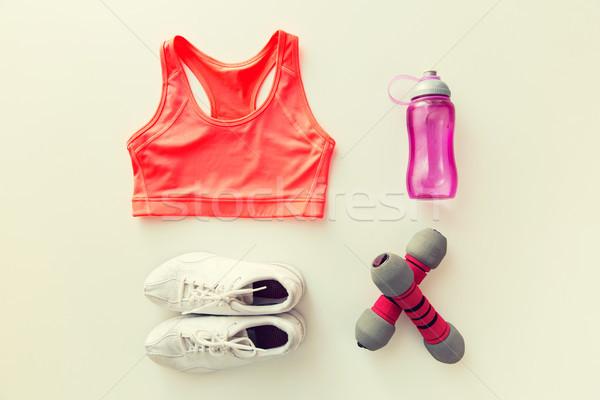 спортивная одежда гантели бутылку спорт фитнес Сток-фото © dolgachov