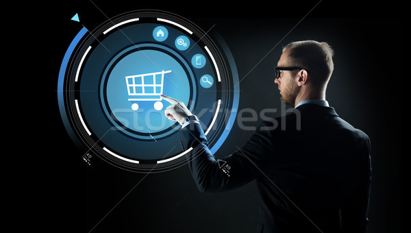 Stock photo: businessman pointing finger to shopping cart