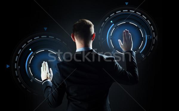 Işadamı dokunmak sanal ekran iş adamları teknoloji Stok fotoğraf © dolgachov