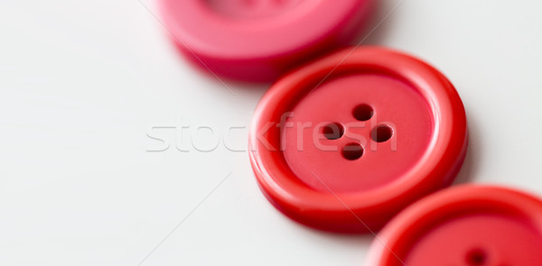 red and pink sewing buttons on white background Stock photo © dolgachov
