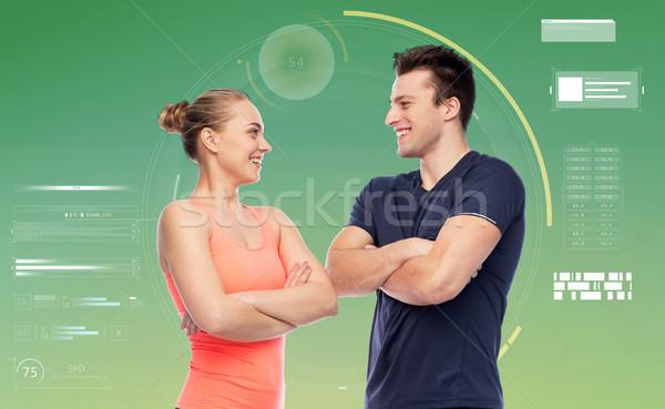 happy sportive man and woman Stock photo © dolgachov