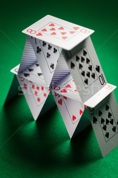 close up of house of playing cards on green cloth Stock photo © dolgachov