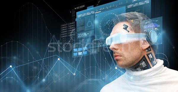 man in virtual reality glasses and microchip Stock photo © dolgachov