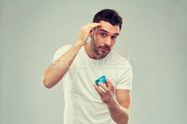 счастливым молодым человеком волос воск гель красоту Сток-фото © dolgachov