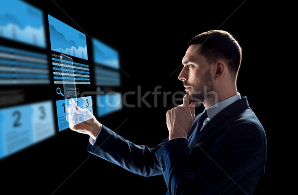 Zakenman uitwisseling charts business realiteit Stockfoto © dolgachov