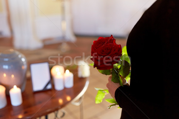 woman with roses and cremation urn at funeral Stock photo © dolgachov