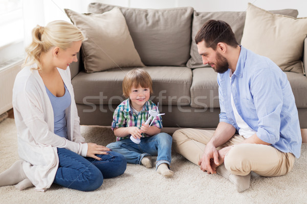 happy family playing with toy wind turbine Stock photo © dolgachov