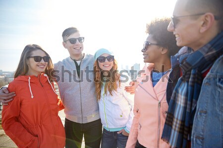 smiling hippie friends having fun near minivan car Stock photo © dolgachov