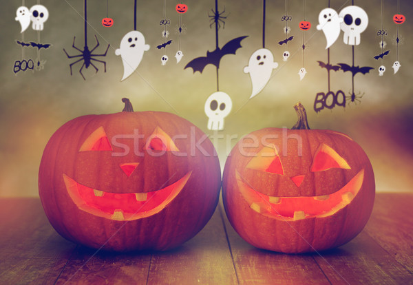 carved pumpkins in witch hat and halloween garland Stock photo © dolgachov