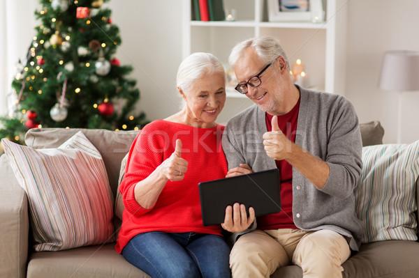 Boldog idős pár táblagép karácsony ünnepek kommunikáció Stock fotó © dolgachov