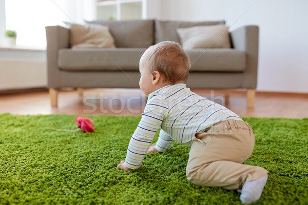 baby boy crawling on floor at home Stock photo © dolgachov