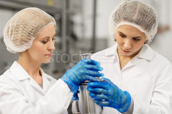 women technologists working at ice cream factory Stock photo © dolgachov
