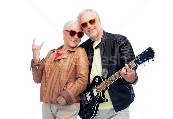 senior couple with guitar showing rock hand sign Stock photo © dolgachov