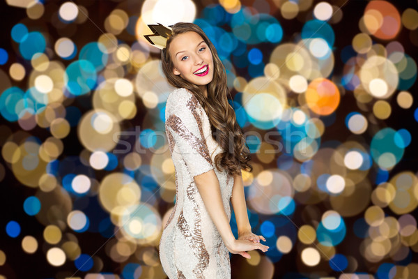 happy young woman in crown over festive lights Stock photo © dolgachov