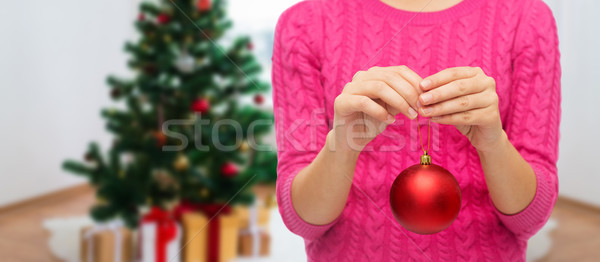 Stock photo: close up of woman hands with christmas ball