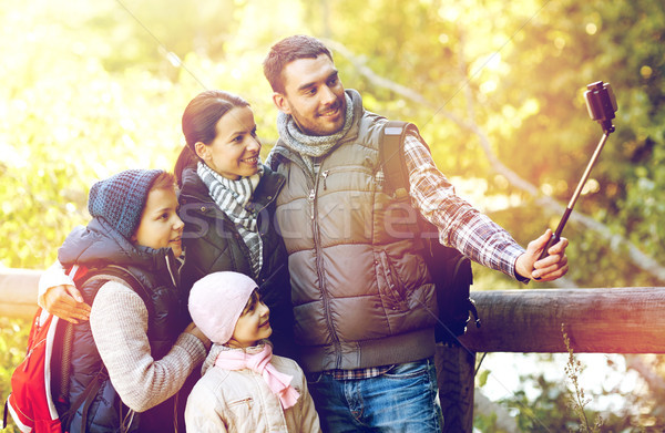family with backpacks taking selfie and hiking Stock photo © dolgachov