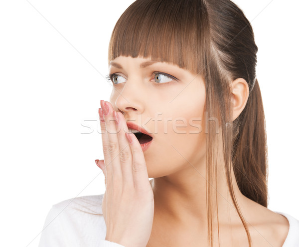 woman with hand over mouth Stock photo © dolgachov