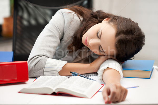 bored and tired woman sleeping on the table Stock photo © dolgachov