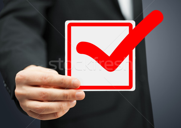 closeup of checkbox and red mark in it Stock photo © dolgachov