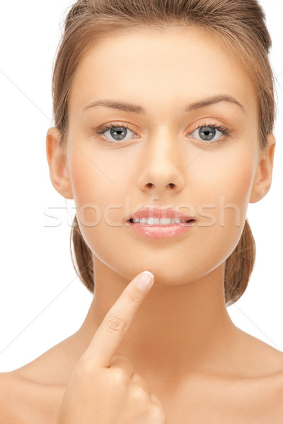 woman touching her chin Stock photo © dolgachov