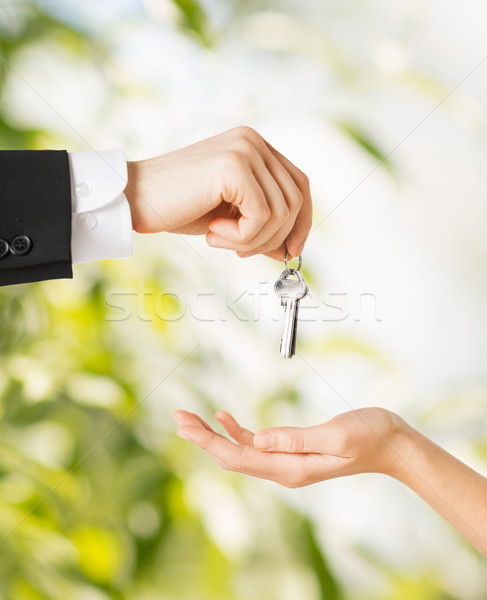 man and woman with house keys Stock photo © dolgachov