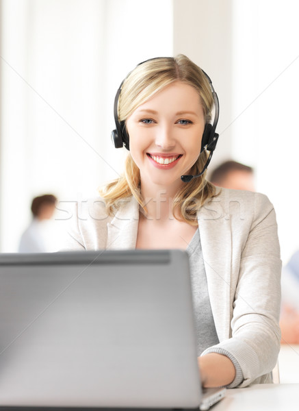 helpline operator with headphones in call centre Stock photo © dolgachov