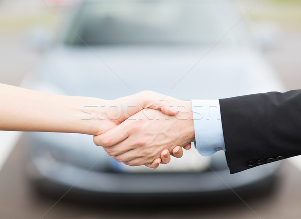 Stock photo: customer and salesman shaking hands