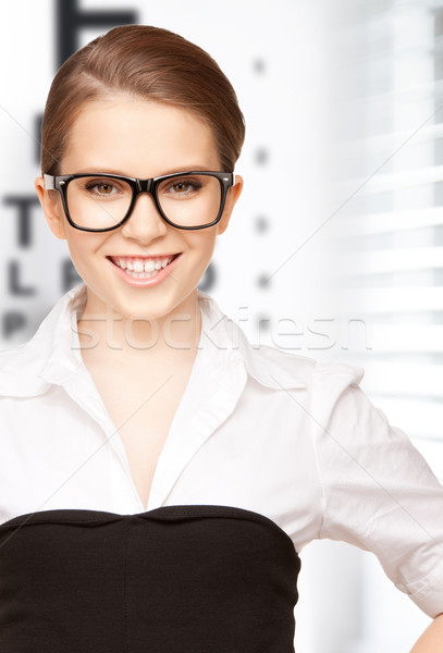 woman in eyeglasses with eye chart Stock photo © dolgachov