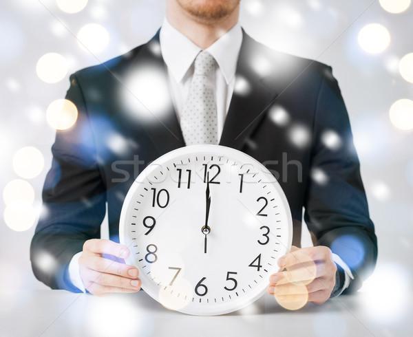 Uomo muro clock 12 Foto d'archivio © dolgachov