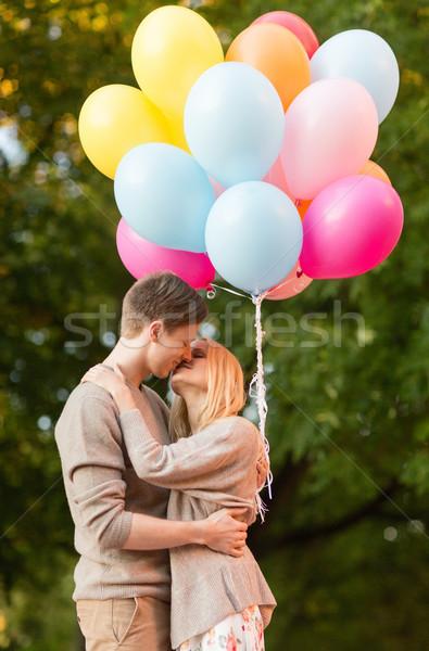 Сток-фото: пару · красочный · шаров · целоваться · парка · лет