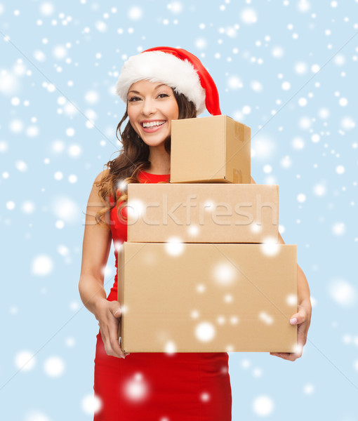 smiling woman in santa helper hat with parcels Stock photo © dolgachov